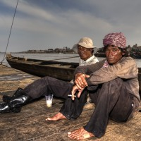 Fishery Workers Relax while Waiting for Another Mass of Catch